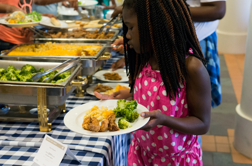 Student-with-Plate-of-Food-beside-Buffet-Line