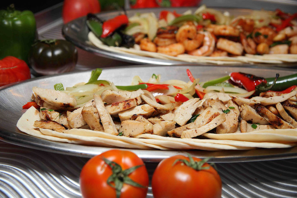 Chicken fajitas with onions and bell peppers